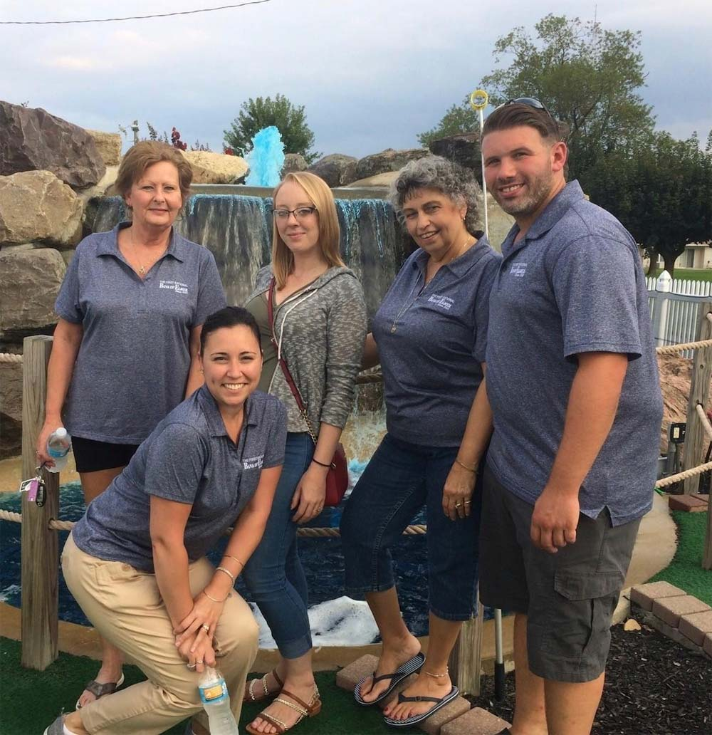 Bank attendees in front of water feature at the Golf Fundraiser