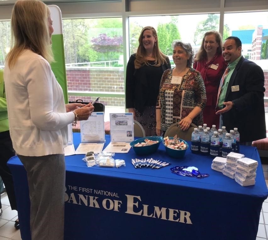 Cumberland roundtable attendees standing at bank table