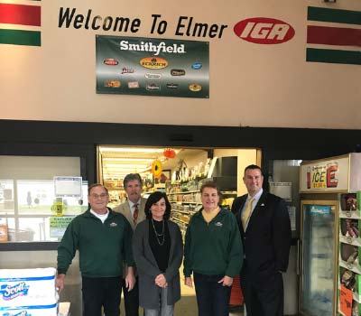 Group from the bank pose inside the local Elmer IGA